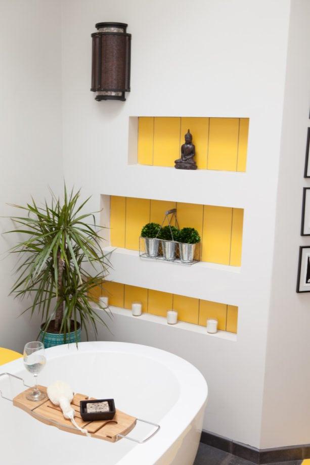 custom yellow niche in a light grey bathroom wall design