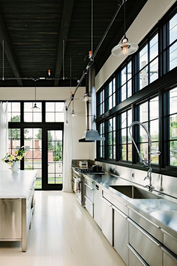 industrial kitchen with an integral sink and wide picture windows over