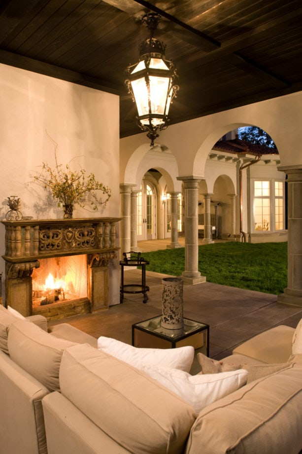mediterranean concrete covered patio with old antique surround fireplace