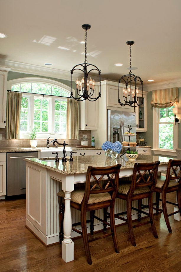 traditional kitchen with a standard undermount sink and picture windows over