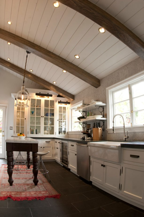 maple white floor to ceiling cabinets in a mountain style kitchen