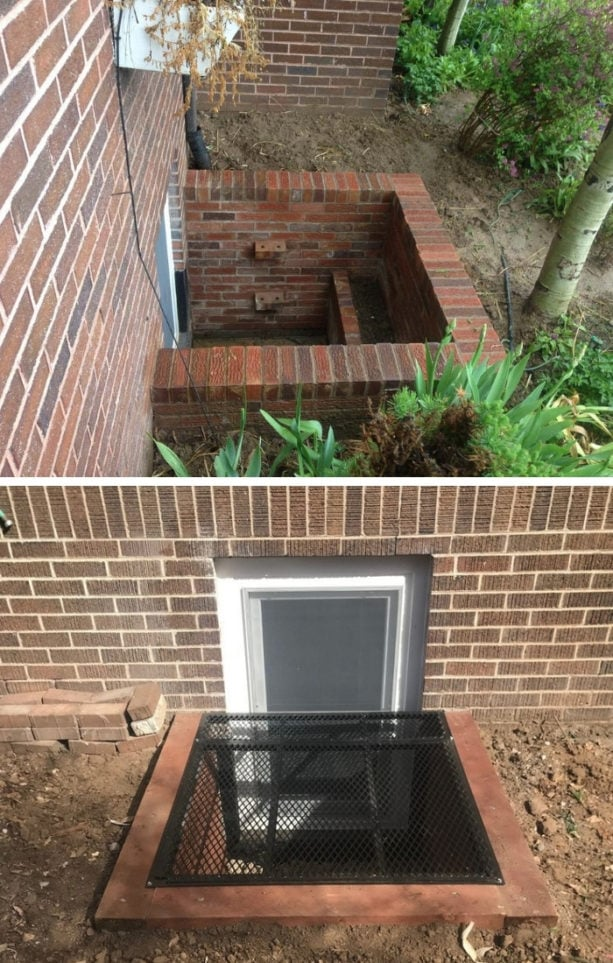red brick basement window well with black cover