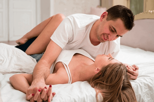 couple having fun on the bed