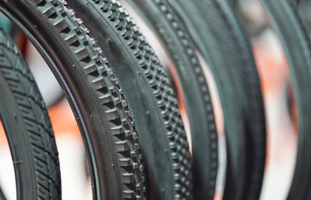 Row of bicycle tires with different treads in a shop
