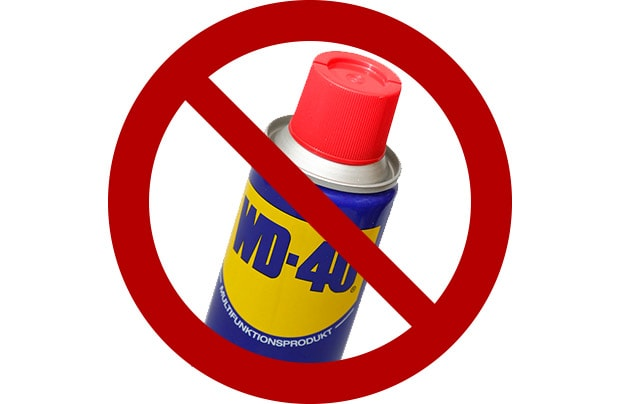 Can of WD40 with the Do Not Use symbol over it