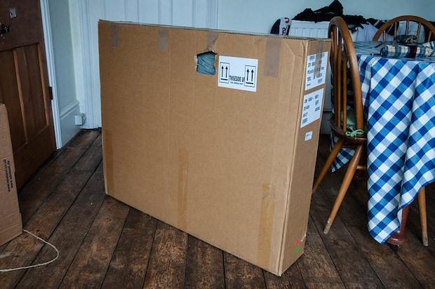 bike in a cardboad box