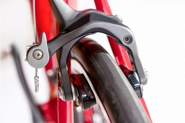 closeup of caliper brakes on a road bike