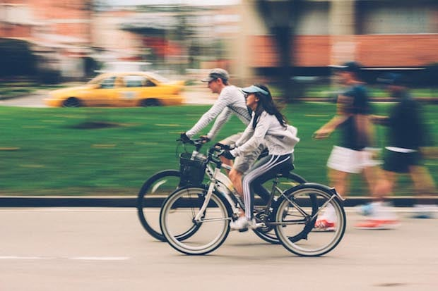 A man and a woman cycle together