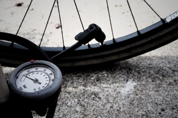 Bicycle pump attachment in place on a tire valve