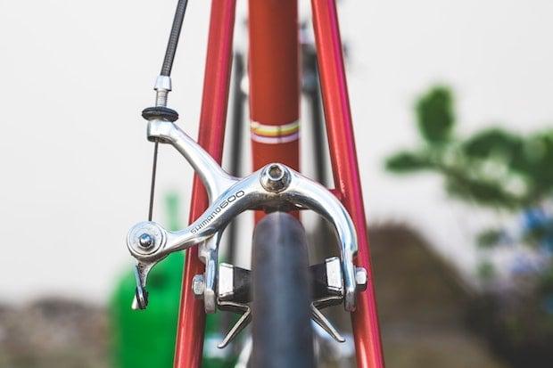 Side-pull caliper break centered over a bike wheel