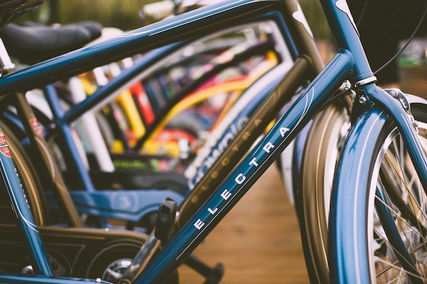 View through the frames of bicycles lined up in a shop