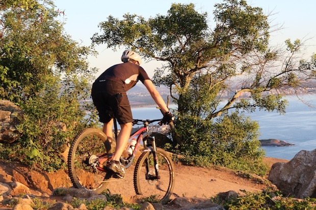 Mountain biker staying under control as he navigates a downhill trail