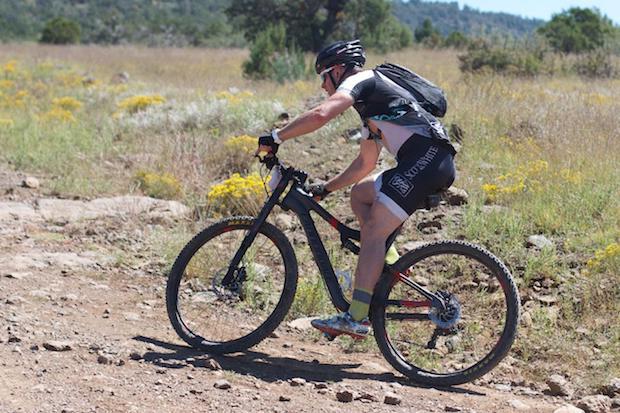 Mountain biker starting on a climb while wearing chamois