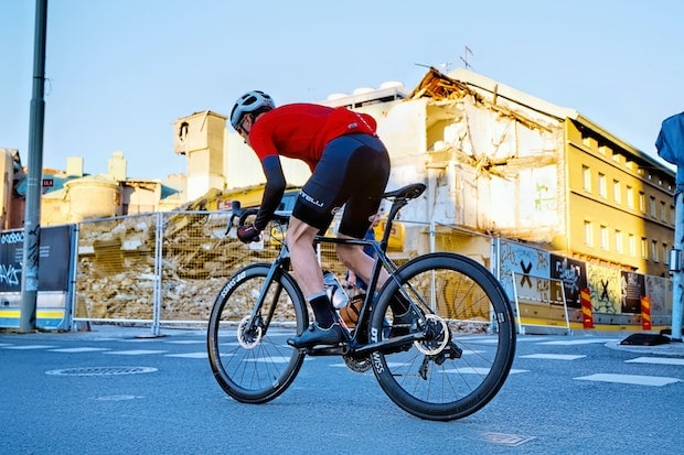 Road cyclist pedaling hard on a carbon bike
