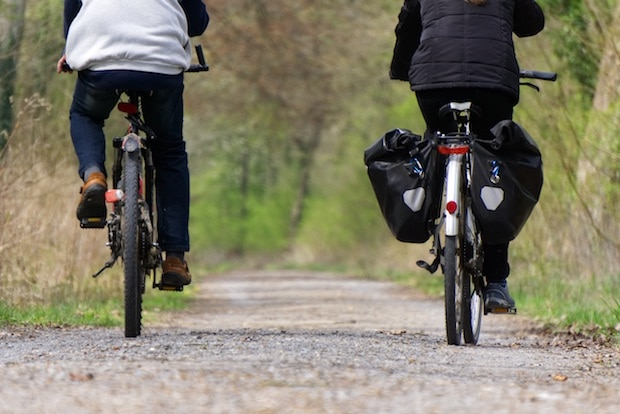 Rear view of two cyclists on a path