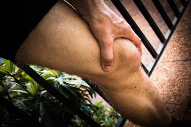 Cyclist holding his knee