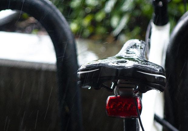 A very wet bike seat in the rain