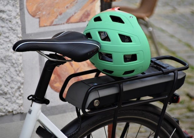 Green helmet on the rack at the rear of a bicycle