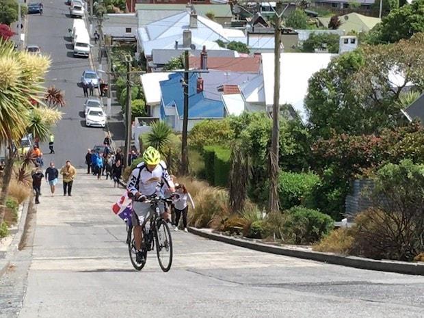 Cycling climbing world's steepest street