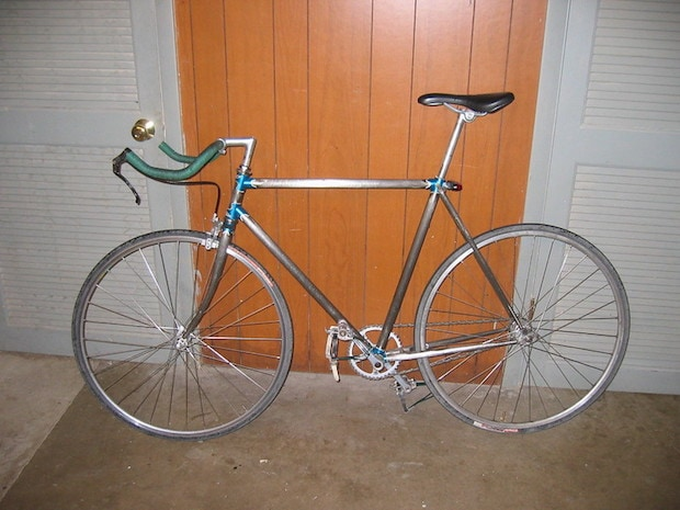 Road bike stripped of paint down to its aluminum frame