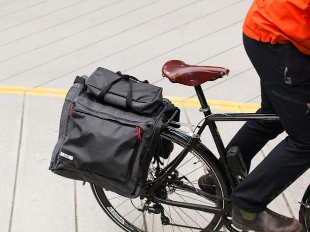 Two Wheel Gear garment pannier on the back of a man's bike