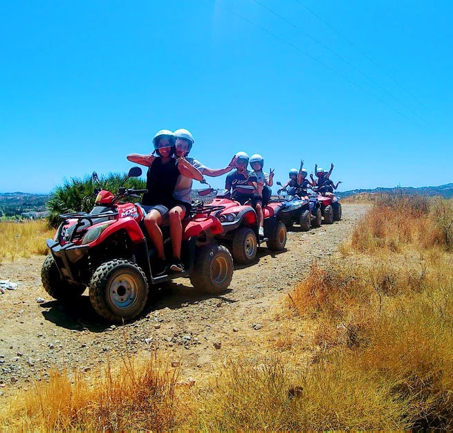 4 quads with riders making faces