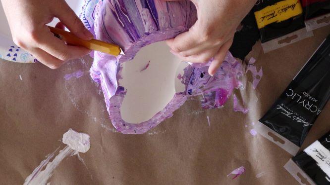sugar skull art in progress, cut off excess dry paint
