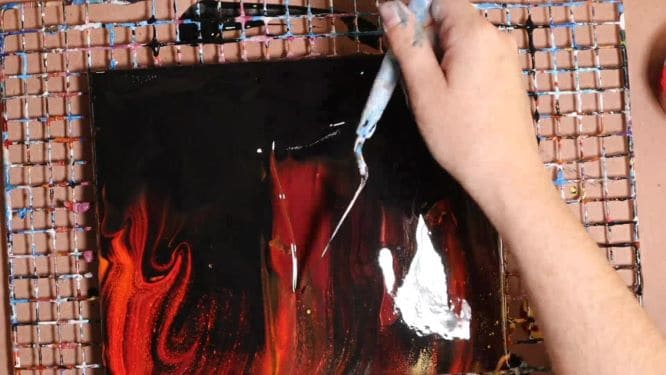 Swipe technique fire painting in progress step-by-step