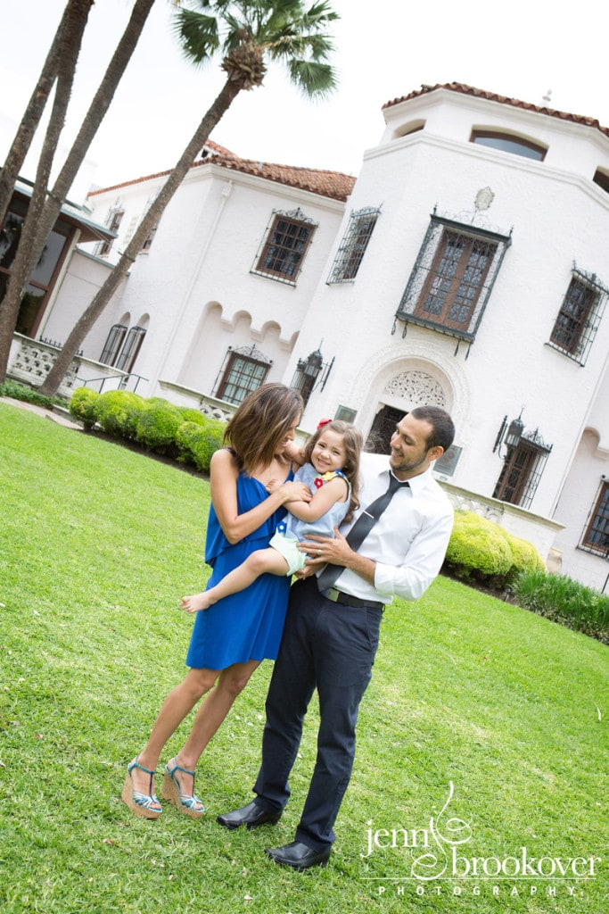 family laughing with daughter in front of the McNay Art Museum