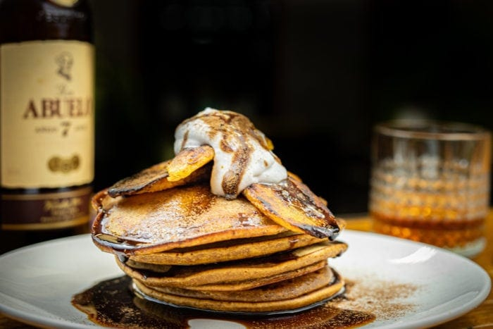 plantain pancake with abuelo 7 rum in th ebackground