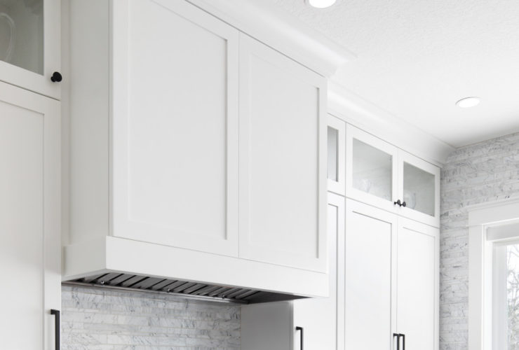 u-shaped shaker white cabinets and black granite countertops in a contemporary kitchen