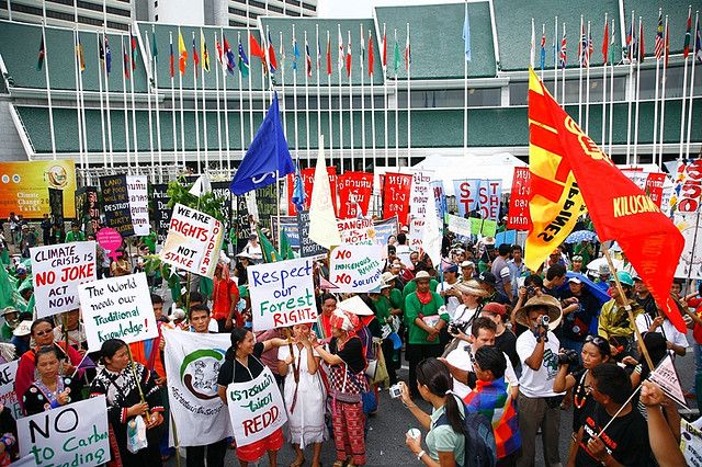Picture: Oxfam International - Civil societies and grassroot communities protest in front of the UN conference center demanding rich nations to step up efforts to reduce greenhouse gas emissions in 2009. Sourced from Flickr and reproduced under a Creative Commons Attribution-NonCommercial-NoDerivs 2.0 Generic (CC BY-NC-ND 2.0) Licence