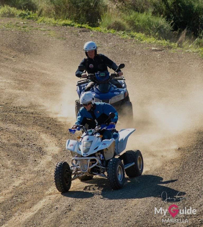two guys racing on quad bikes
