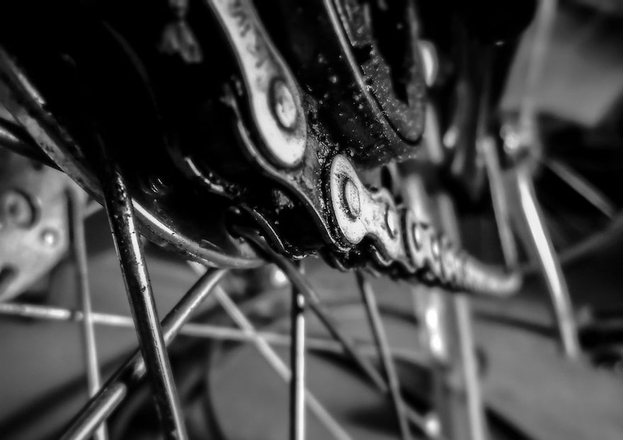 Closeup image of a greasy bicycle chain