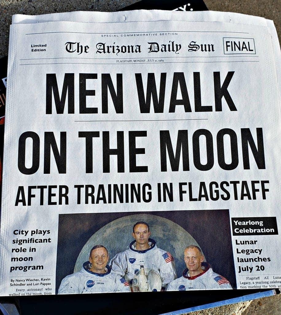 "newspaper headline that reads ""Men Walk on the Moon after Training in Flagstaff"""