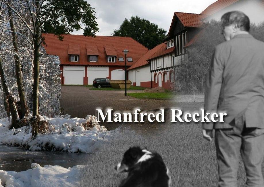 A man standing next to a dog