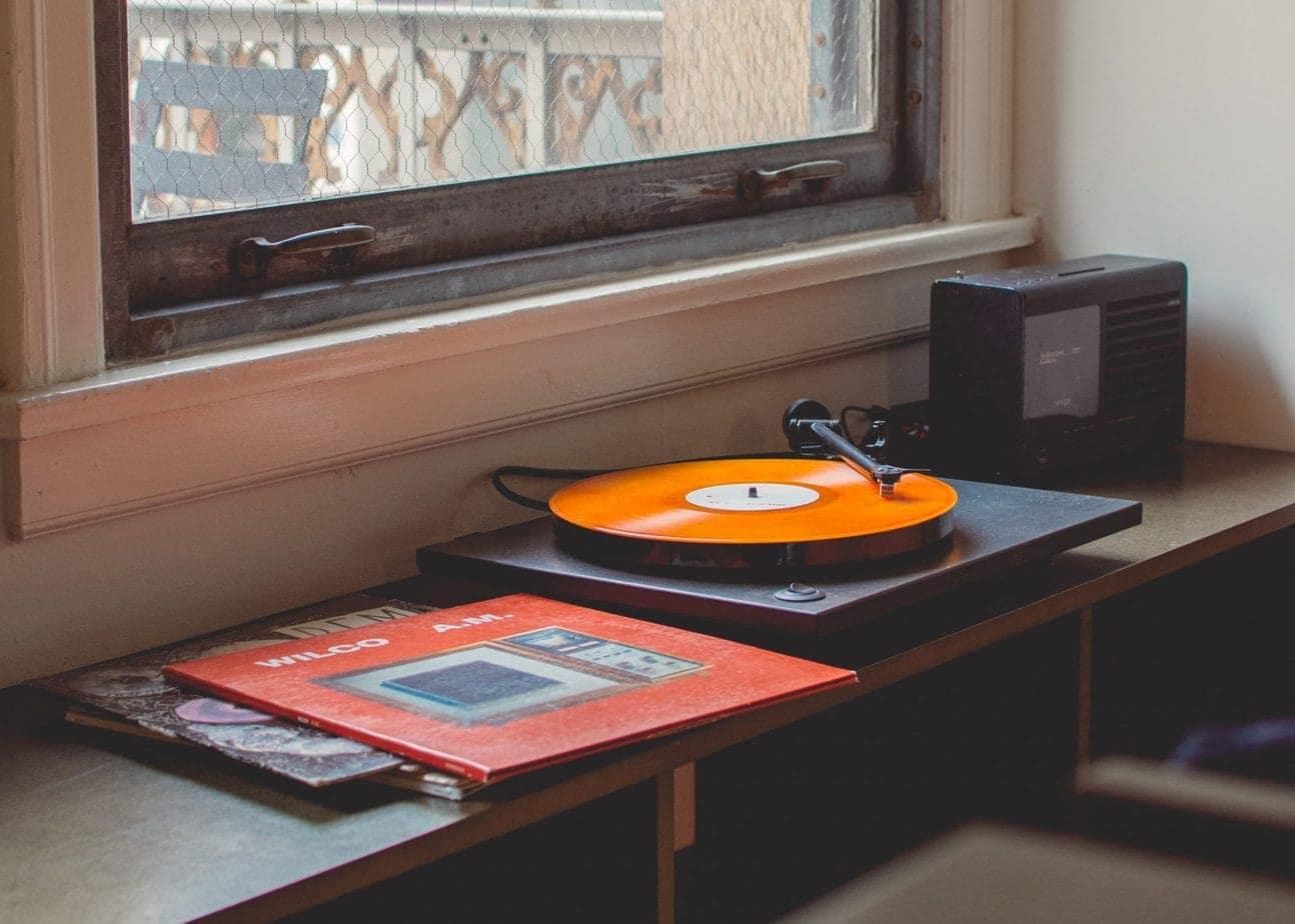 Record Player with Orange Record near Window