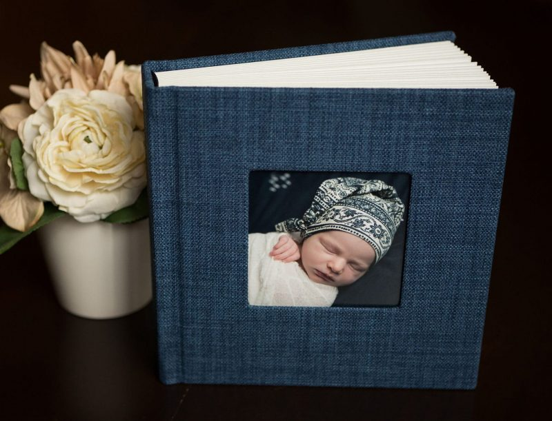 woven navy blue album newborn portraits in San Antonio