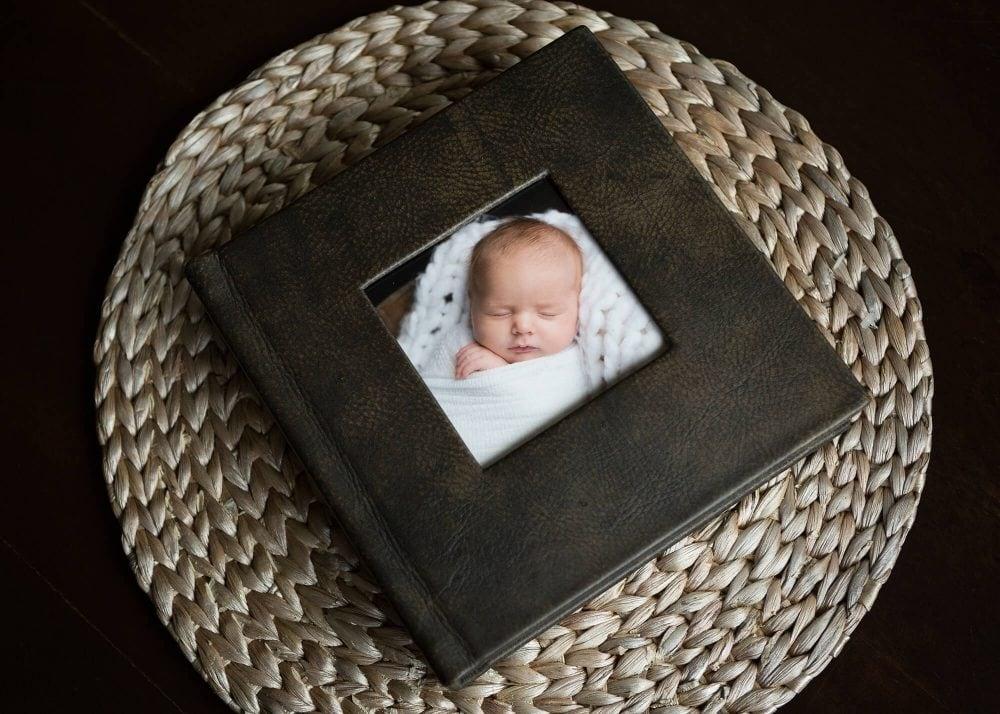 dark brown leather album cover newborn portrait session San Antonio