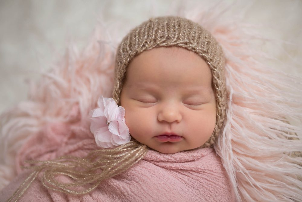 newborn portrait girl pink and gold
