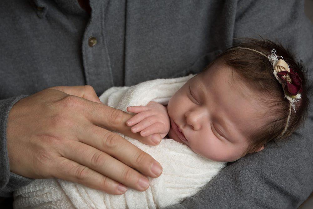 newborn girl in dads hands San Antonio newborn