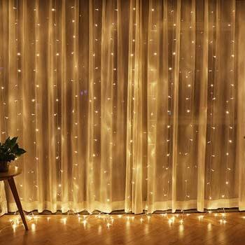 6: Twinkle Star 300 LED Window Curtain String Light