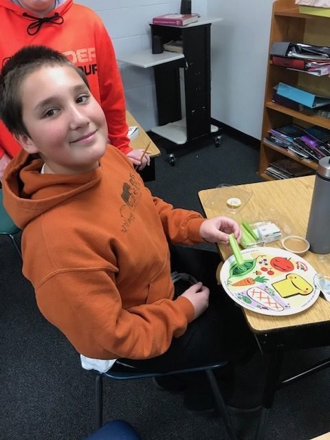Students looking where their snack goes on MyPlate Harrison Elementary jpg
