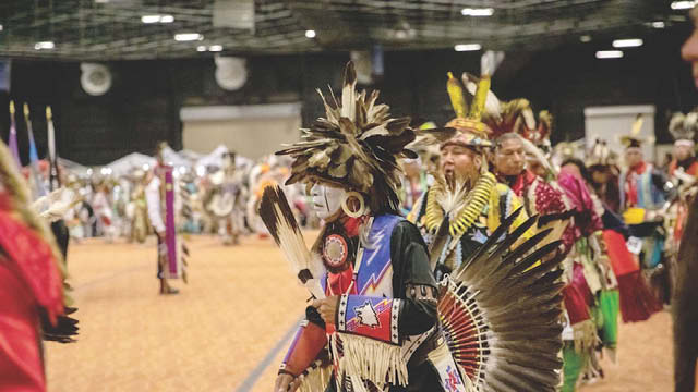 Dancers in native regalia.