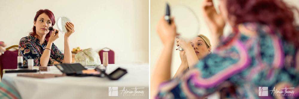 Bridesmaids applying makeup.