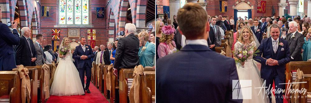 Bride arriving at alter at St Catherines church in Pontypridd