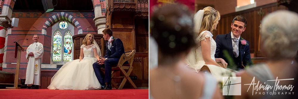 Groom looking at bride sat on chair at altar St Catherines Pontypridd