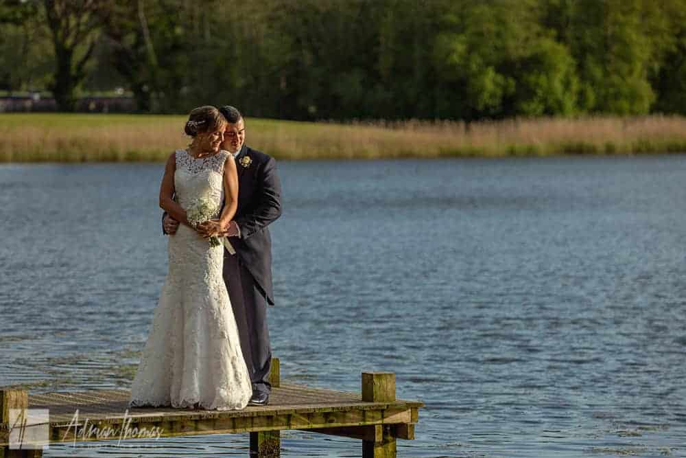 Photograph of bride and groom at Hensol Castle lake.