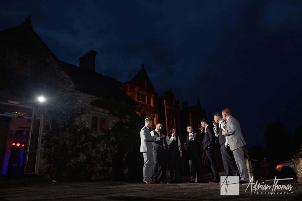 Broom and ushers enjoying cigars at Miskin Manor Manor wedding celebrations