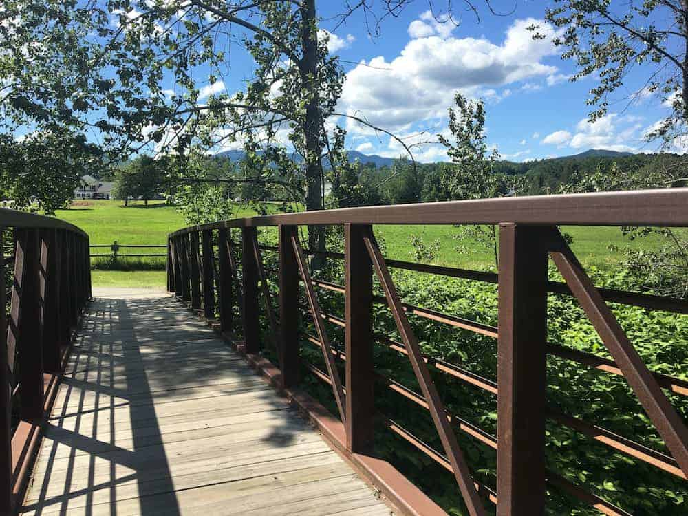 The stowe recreation path crosses bridges and offers field and mountain views.